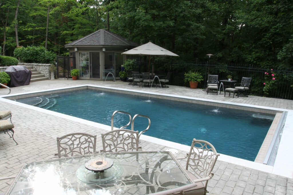 Gunite pool with white marble