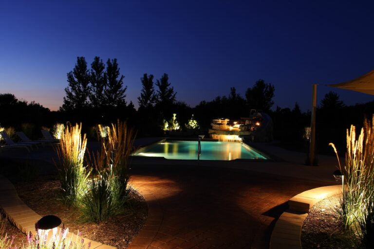 gunite pool with water slide and water falls at night