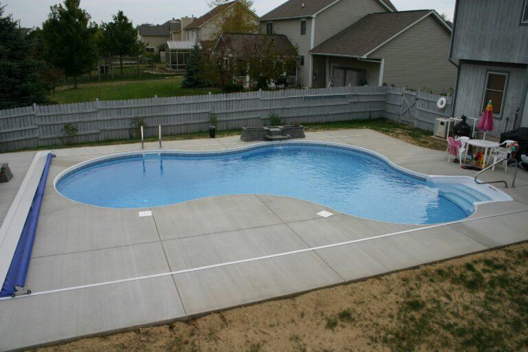 Swimming pool backyard installation by Aquarius pools and spas
